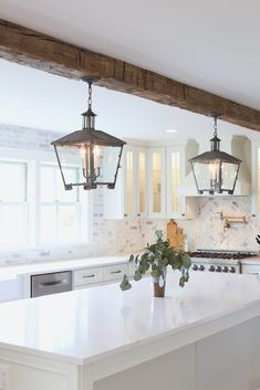 all white kitchen with reclaimed wood beam from real antique wood - lindsay marcella design How To Antique Wood, All White Kitchen, Wood Beams, Antiques, Kitchen Island, Design, Home Decor, Wood Ceiling Beams, Antiquities