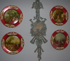 """In the powder room is a set of Daher tin plates of """"The Four Seasons"""" by Nicolas Lancret (1690-1743), with a Sirocco junk shop pendant in the middle."""