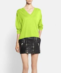 Spicing up the wardrobe with this neon yellow sweater by Saint Laurent.