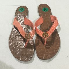 Tory burch sandals Authentic Tory burch sandals. They are women's size 8. They are a coral color thong. The bottom has her signature style. The top has a circle gold tone signature style hardware T. Great for spring. These are super rare color Tory Burch Shoes Sandals