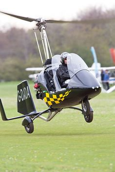 The Rotorsport UK MT03 autogyro G-DADA taking off from Popham during the Microlight Trade Fair