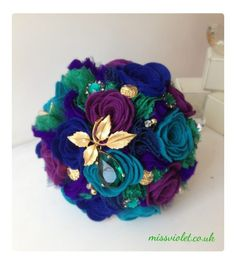 Handmade peacock colour felt bouquet with button and brooch detailing £125.00