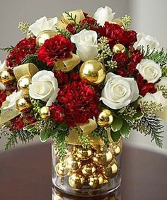 Shop Christmas flowers & gifts for delivery to celebrate the season! Find beautiful Christmas floral arrangements and holiday flowers. Christmas Flower Arrangements, Christmas Flowers, Christmas Table Decorations, Noel Christmas, Winter Christmas, Christmas Wreaths, Christmas Crafts, Red And Gold Christmas Tree, Christmas Floral Designs