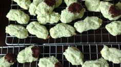 These are tender and delicately flavored cookies - the light green color and chocolate drizzle make them stand out on a cookie tray.  Nice for holidays or bridal showers.