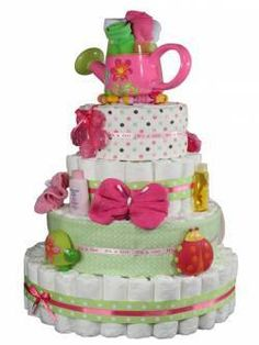 """Diaper Cake! If your anything like me you love to discover new ways to create unusual """"Eye Candy""""! How about you turn something associated with baby Opppsies into an awesome masterpiece that also saves a new mom some extra cash!"""