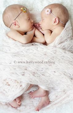 newborn twins wrapped together