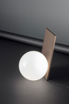 EXTRA table lamp by Michael Anastassiades for FLOS.