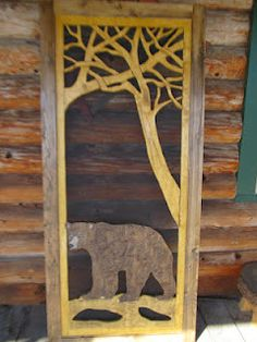 "Lodge Style Screen Door featuring ""Saranac"" the Bear under intertwined Branches."