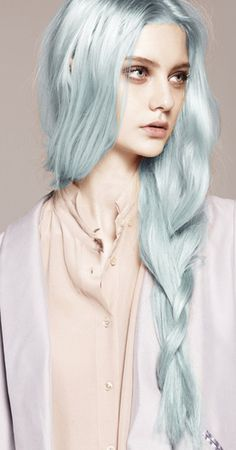Pastels In for 2013: Long braided hair on side with a 2013 pastel green hair color