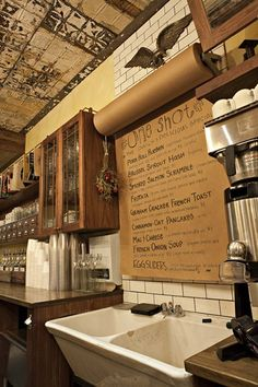 One Shot Coffee: Crafting History Through Interior Design | Apartment Therapy  A roll of craft paper serves as the menu.