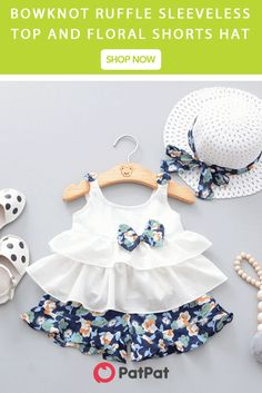 Adorable Bowknot Ruffle Sleeveless Top and Floral Shorts Hat Set for Baby Girl * Bowknot decor * Material: Cotton * Machine wash, tumble dry * Includes: 1 top, 1 bottom, 1 hat * Imported Baby Girl Frocks, Frocks For Girls, Dresses Kids Girl, Kids Frocks Design, Baby Frocks Designs, Baby Girl Dress Patterns, Baby Dress Design, Skirt Patterns, Coat Patterns