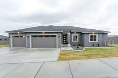 This contemporary stucco home features clean-lined trim and a sleek modern door. Stucco House Colors, House Paint Exterior, Dream House Exterior, Exterior Siding, Modern Door, Modern Exterior, Exterior Colors, Home Building Companies, Stucco Homes