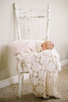 This sweet little nursery is powered by vintage florals and lace and it's 100% gorgeous.