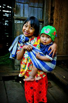 Carrying her brother in Thailand