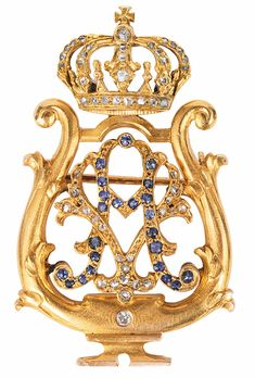 """A noble diamond sapphire brooch with monogram of Auguste Victoria.    Late 19th cent. 18 ct. yellow gold. A classical aristocracy brooch of a court lacy with crown and monogram """"AV"""" of Auguste Viktoria, wife of prince Wilhelm of Prussia, since 1888 german empress and queen of Prussia. Decorated with 52 diam. and 20 small sapphires"""