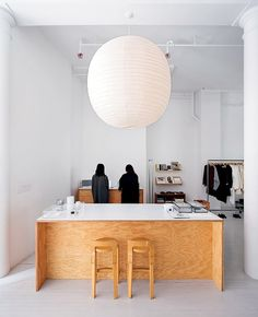 An oversize Noguchi light hangs over the plywood checkout counter at La Garçonne.