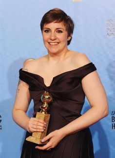 """Lena Dunham, winner of Best Actress in a Television Series (Musical or Comedy) for """"Girls,"""" poses in the press room during the 70th Annual Golden Globe Awards.  Photo by Kevin Winter/Getty Images"""