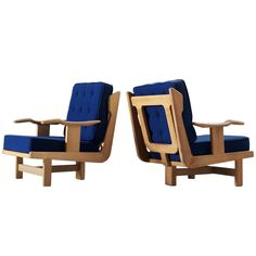 Guillerme et Chambron Pair of Solid Oak Lounge Chairs | See more antique and modern Lounge Chairs at https://www.1stdibs.com/furniture/seating/lounge-chairs