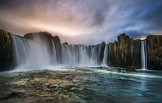 This spot in northern central Iceland is a bit perilous to reach. It's so perilous here at Godafoss, in fact, that I am glad my mom didn't see me getting into position. Is the water cold? Yes, yes it is.  - Akureyri, Iceland  - Photo from #treyratcliff Trey Ratcliff at http://www.StuckInCustoms.com