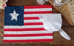Show off your Patriotic spirit with our American flag quilted placemat. Machine washable, this placemat can be used at your Independence Day barbecue and as your everyday table setting. #Americana #American #Decor