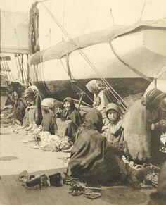 Athapascan women selling crafts on board USS Patterson, Norton Sound, Alaska, ca.1898