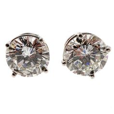 Bright White Diamond Platinum European Ideal Cut Stud Earrings | From a unique collection of vintage stud earrings at https://www.1stdibs.com/jewelry/earrings/stud-earrings/