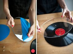 So awesome!  Items Needed:Records! (you can use 12″/10″/7″)Two pieces of clear plexiglass acrylic (cut to size, with a hole drilled directly in the middle)A sturdy base with a flat top (I used thrifted candlesticks)Clear screw fastener(I used 3/8 in. and cut them down a little for a perfect fit)A strong glue  Step One:Take the plastic off your freshly cut acrylic, and place one piece on each side of your record to make sure it fits. You'l...