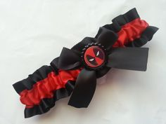 Hey, I found this really awesome Etsy listing at https://www.etsy.com/listing/194969012/deadpool-themed-wedding-garter