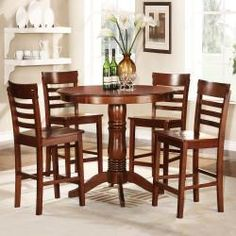 @Overstock.com - This round counter height table set is great for entertaining. Makes a classic addition to any casual décor, showcase traditional pedestal base and ladder chair back design. This collection makes a perfect centerpiece and eye catching furniture pieces.  http://www.overstock.com/Home-Garden/Adrienne-Antique-Oak-5-Piece-Dining-Set/6420583/product.html?CID=214117 $502.99