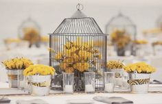 lovely bird cage and yellow flowers!   Been looking for a cage just for this ;)
