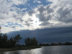 A cloudy sky by the pond at the East side dog park, Casper, Wyoming