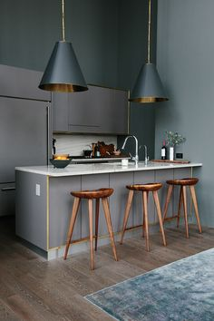 Grey pendant lighting with gold interior accents add an extra dimension to this tiny galley kitchen, and despite the lofty ceilings, make it feel considerably more cosy. - Interior Homes Küchen Design, House Design, Interior Design, Gold Interior, Design Ideas, Design Inspiration, Design Trends, Modern Design, Kitchen Interior