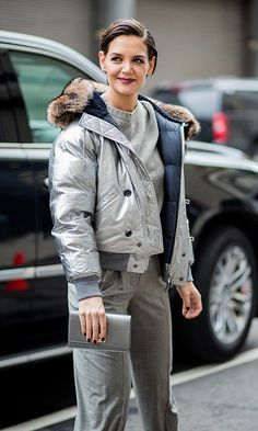 Ralph Lauren front row guest Katie Holmes's deep lip and nail color was a trendy contrast with her all-grey outfit, which was topped with a silver parka.