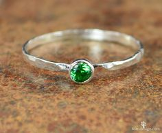 These dainty rings make such a stunning fashion statement! This thin silver band is set with a dainty 3mm Emerald Green conflict free cubic zircon - May's birthstone! These rings are beautifully worn