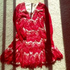 Red lace dress, never work, brand new, size S/M This dress is in excellent condition, but never worn because it is too small on me. The size says large but it fits more like a small/medium. Looks amazing when it is on and it is fully lined. A little flirty with the front tie, red lace, and slight flare at the bottom. 3/4 sleeves Dresses Mini