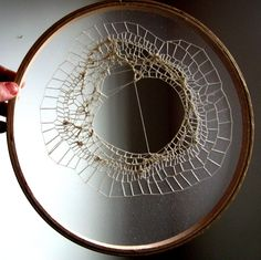 transparent textiles | cotton thread on a single layer of tulle in an embroidery hoop