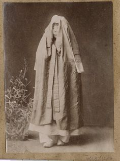 [Korean woman wrapped in cloak] 1904. Korean women from the upper class wore cloaks over their heads on outings, called essugae chimae or changot, which is a coat-style veil. Since the time of King Sejo (1417-1468, women wore this robe worn by the men, and it then evolved as a veil for women. Collection: Willard Dickerman Straight and Early U.S.-Korea Diplomatic Relations, Cornell University Library