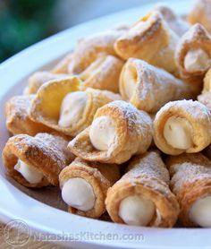 Merry Christmas!! Europeans celebrate Christmas January 7th; oh my the party continues! You don't have to wait for a party to make these puff pastry cream horns. They are easy and super impressive. Mom has a large stash of these molds and we made trubochki...