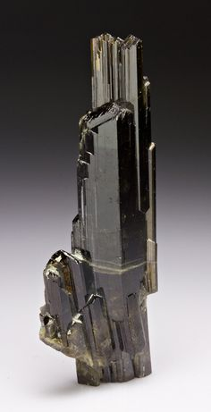 Epidote is a calcium aluminium iron sorosilicate mineral.  Many of the characters of the mineral vary with the amount of iron present for instance, the color, the optical constants, and the specific gravity. The color is green, grey, brown or nearly black, but usually a characteristic shade of yellowish-green or pistachio-green.