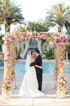 floral wedding arch with pink and purple blooms ~  we ❤ this! moncheribridals.com
