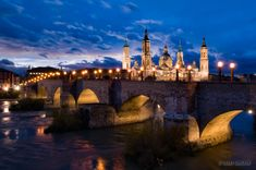 The Basilica of Our Lady of the Pillar and the Puente de Piedra spanning the Ebro River in Zaragoza, Spain.