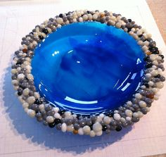 Rock edge bowl.  All made out of glass.  $75  Obviously there is nothing new under the sun:  I had been envisioning such a bowl using Blu Italy glass, and then coating little pebbles of glass with different colours of mica - silver and gold? - to layer around the edge.