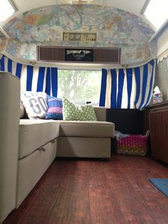 Ikea Manstad couch & vintage map wallpaper in this cute camper renovation
