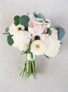 Peony, ranunculus and anemone wedding bouquet: http://www.stylemepretty.com/2016/10/19/modern-atlanta-restaurant-wedding/ Photography: Sawyer Baird - http://www.sawyerbaird.com/