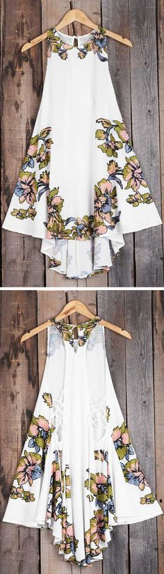 You have to be kind while wearing this dress! It's so precious and sweet it just rubs off on you and everyone around you! Those gorgeous flowers look great on that white background! You will love it's loose and flowing cut too!
