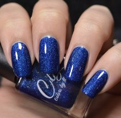 Colors by llarowe PotM - March 2017 - The Resistance is deep royal blue scattered holographich with holo prismatic flakes that show a brighter blue flame. Swatch photo by @polishedtothenines on Instagram.