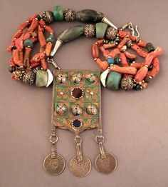 Africa   A silver, enamel, amazonite, coral, shells and glass bead necklace from Morocco   The enamelled amulets (Herz) are worn by the Jewish women of the Anti-atlas and are often mounted on multi- stones necklaces … these amulet are supposed to protect those who wear them against the bad fate   1 800€