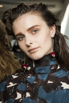 Spring 2015 beauty - Hair at Marni, by Paul Hanlon was worn textured, damp-looking and swept back from the face.