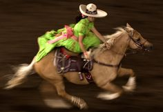 Escaramuza - (mexican cowgirls) they compete against other organizations and show their skills to an audience of onlookers. Just think, all this is done while riding side saddle. It really is a thing of beauty to be able to see this in person.!