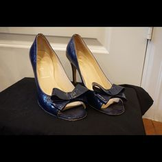 Butter Navy Open Toe Bow Pump Open toe, bright navy leather, made in Italy.  Worn a few times, only sign is slight Nick on upper right heel (see pic).  4inch heel Butter Shoes Heels